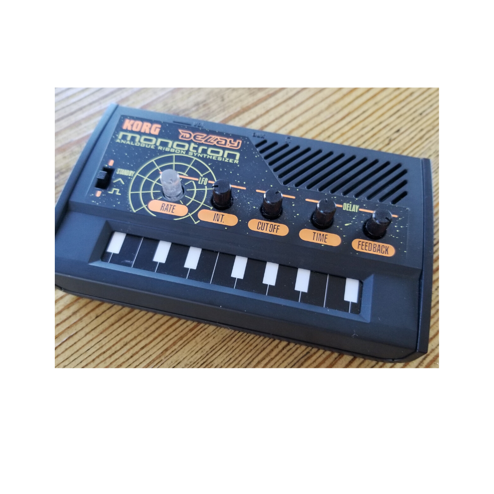 The Korg Monotron Delay is very small ribbon synthesizer with built-in effects, a filter, and adjustable LFO